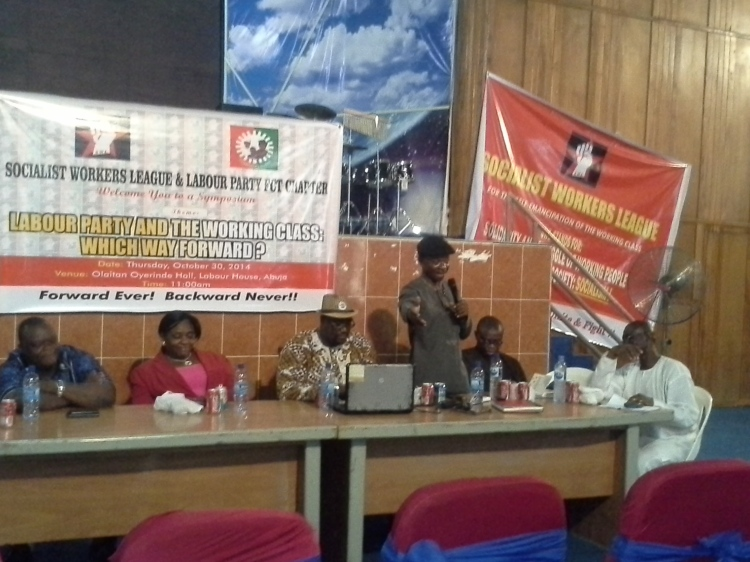 Yahaya Abdullahi, Chair NLC FCT Council, speaking at the symposium